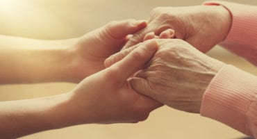 36361850 - old and young holding hands on light background, closeup