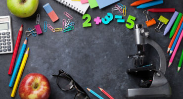 60509539 - supplies over chalk board for your text. back to school concept with copy space